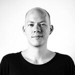 Portrait photo(black and white) of Alex Feyerke.