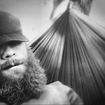 Portrait photo(black and white) of Cole Gillespie.