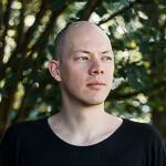 Portrait photo(colour) of Alex Feyerke.